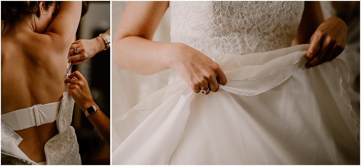 Photographe de mariage chateau boisrigaud usson auvergne enfilage de la robe